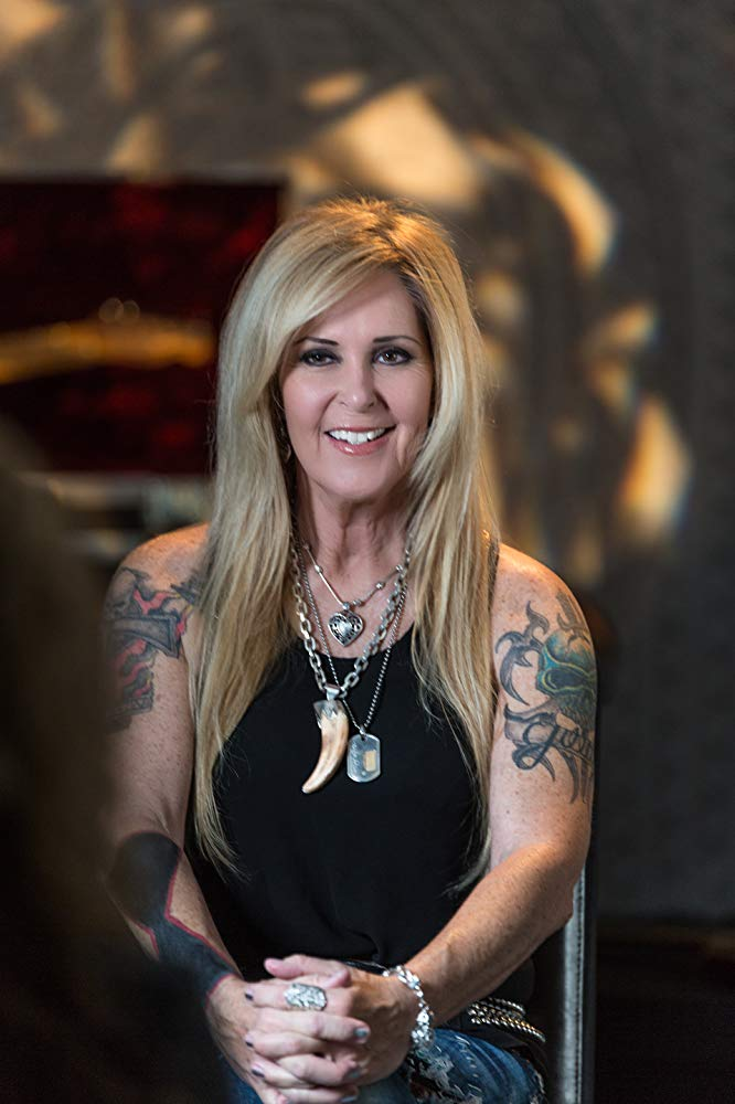 How tall is Lita Ford?