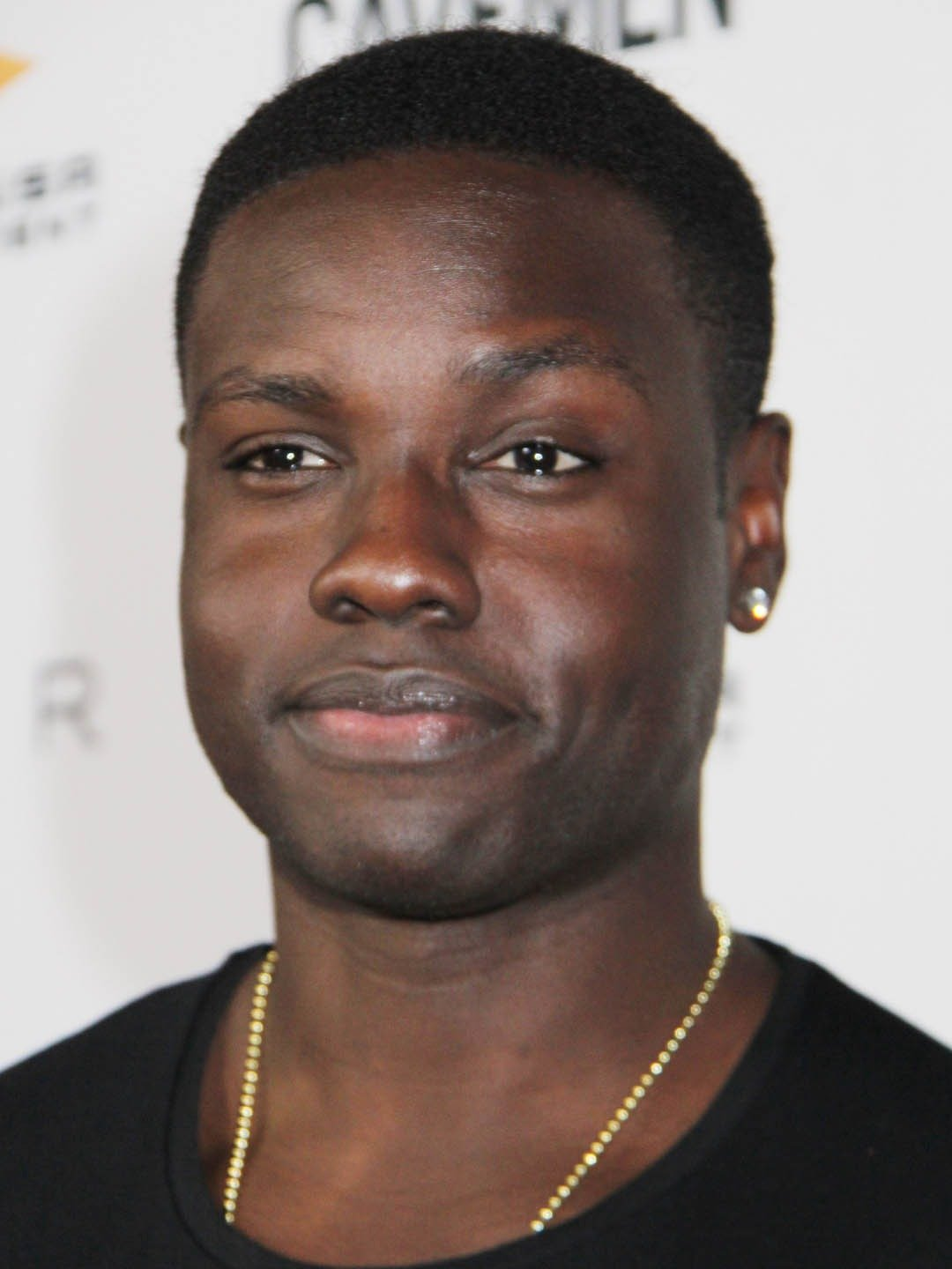 How tall is Dayo Okeniyi?