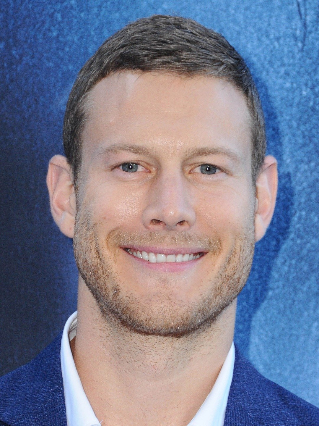 How tall is Tom Hopper?